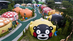 Inside the bizarre Japanese 'health resort' filled with hundreds of Teletubbies-style homes built to withstand earthquakes